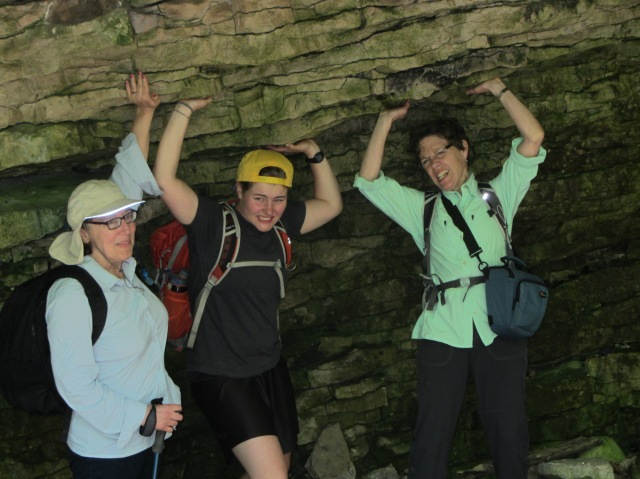 We found this rock overhang that had a serious sag. Fearing that it would collapse onto some poor hiker, the ladies used brute force to lift it back up into proper position.