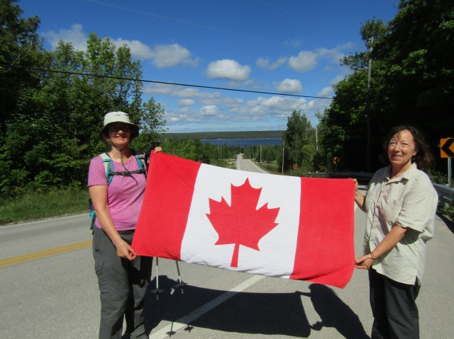 The flag beareres representing both Canada and the Limestone Ladies!